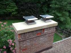 Concrete chimney crown with ran caps